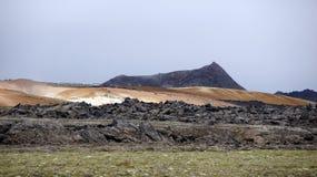 Krafla black mountain Leirhnjúkur and lava field. Black and red coloured mountain Leirhnjukur and lava field in the Krafla volcano area in Iceland royalty free stock photography