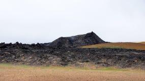 Krafla black mountain Leirhnjúkur. Black and red coloured mountain Leirhnjukur in the Krafla volcano area in Iceland stock images
