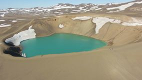 Krafla Caldera and Tourists. Volcanic Crater. Iceland. Aerial View
