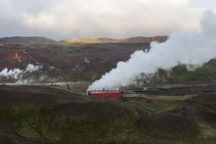Krafla geothermal Power Station steaming. royalty free stock image