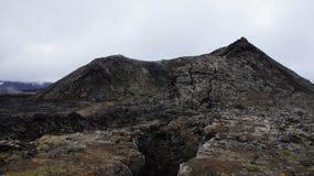 Krafla hot lava field and Leirhnjúkur mountain. Steaming hot lava field and the Leirhnjukur mountain of the Krafla volcano in Iceland royalty free stock images