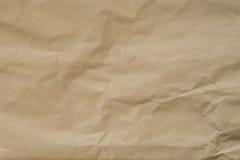 Kraft brunt papper och skrynklig bakgrundstextur med utrymme royaltyfri fotografi