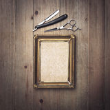 Kraft canvas with a vintage frame and barber tools Royalty Free Stock Images