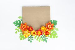 Kraft envelope with floral of paper ornament. Apartment, top view. stock photos
