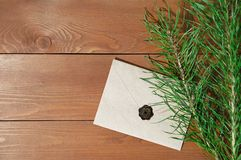 Kraft envelope and spruce branches royalty free stock images