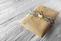Kraft envelopes with letters and padlock, chain on old white wooden background. Protection of your post, PC mailing. Blanks for th. E designer. Concepts, ideas Royalty Free Stock Photo