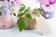 Kraft gift box, peonies and lilac flowers Royalty Free Stock Image