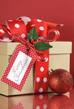 Kraft gift box with red polka dot ribbon Royalty Free Stock Image