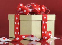 Kraft gift box with red polka dot ribbon Stock Photos