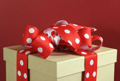 Kraft gift box with red polka dot ribbon Royalty Free Stock Images