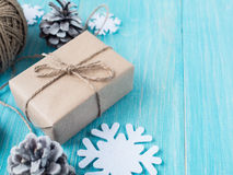 Kraft gift boxes, bead, snowflakes, Christmas decorations, cones on the wooden blue background. Shallow Selective focus Royalty Free Stock Image