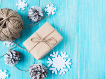 Kraft gift boxes, bead, snowflakes, Christmas decorations, cones on the wooden blue background. Shallow Selective focus Royalty Free Stock Photography