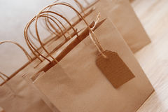 Kraft paper bags for Christmas gifts. With tags Stock Image