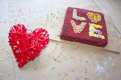 Love and romance Valentine`s day red velvet cake red heart Stock Image