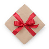 Kraft paper gift box with ribbon bow from above Stock Photos