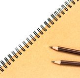 Kraft paper note book and pencil on white. Royalty Free Stock Photo