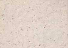 Kraft paper texture. Texture of kraft paper sheet with dark brown grain shavings stock image