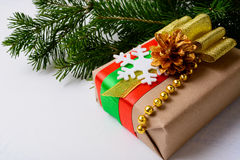 Kraft paper wrapping Christmas gift decorated with snowflake Royalty Free Stock Photography