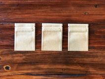 3 Kraft Paper zipper lock bag on the vintage wooden table royalty free stock photos