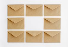 Kraft postal envelopes on a white background. royalty free stock images