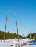 Kraftledning och en telefonlinje Fotografering för Bildbyråer