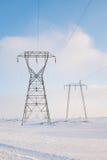 Kraftledningar i vinter Fotografering för Bildbyråer