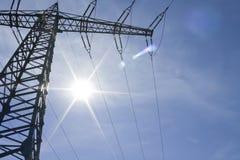 Kraftledningar och sol- energi Royaltyfria Bilder