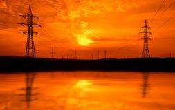 Kraftledningar på solnedgången Royaltyfria Foton