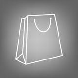 Kraftpapiertaschenikone Flaches Zeilendarstellung lokalisierter Vektorgegenstand stock abbildung