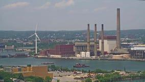 Kraftwerk mit Windmühle stock footage