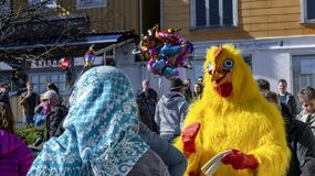 Easter jumps into the fjord water in Norway. Kragero, Norway - April 12, 2015: Easter traditions in southern Norway: organic farming market - `Bondens marked` stock images