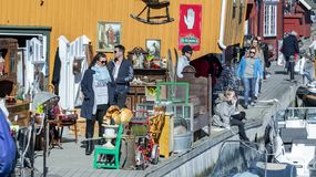 Norwegians rest on the shore of the fjord among traditional architecture, spring and Easter. Kragero, Norway - April 12, 2015: Easter traditions in southern stock image