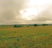 Krajobraz z podeszczowymi chmurami Zdjęcia Stock