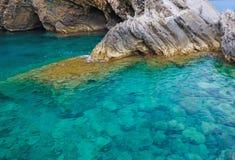 Krajobrazowa plaża, skały, jasny Obraz Stock