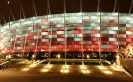 Krajowy stadium w Warszawa iluminował przy nocą krajowymi kolorami Fotografia Stock