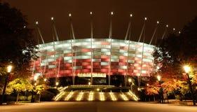Krajowy stadium w Warszawa iluminował przy nocą krajowymi kolorami Obraz Stock