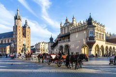 Kraków Cloth Hall and St. Mary's Basilica at the Main Market Square. KRAKOW, POLAND - OCT 7, 2014: Kraków Cloth Hall Sukiennice and St. Mary's Basilica Royalty Free Stock Photos