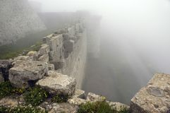 Krak de Chevaliers hidden in deep fog. Medieval Castle - Krak de Chevaliers hidden in deep fog Stock Photos