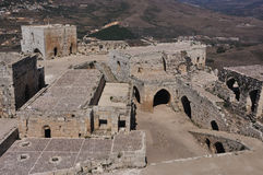 Krak des Chevaliers. Transliterated Crac des Chevaliers, is a Crusader fortress in Syria and one of the most important preserved medieval military castles in Stock Image
