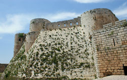 Krak des Chevaliers, crusaders fortress, Syria. Krak des Chevaliers, citadel tower, fortification castle walls , crusaders fortress, Syria Royalty Free Stock Images