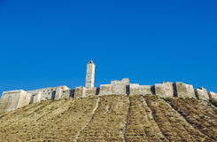 Krak des Chevaliers east of Tartus, Syria. Krak des Chevaliers (also Crac des Chevaliers) is a Crusader castle in Syria and one of the most important preserved Royalty Free Stock Image