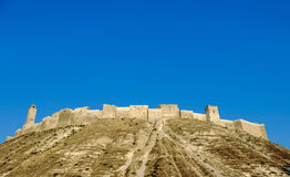Krak des Chevaliers east of Tartus, Syria. Krak des Chevaliers (also Crac des Chevaliers) is a Crusader castle in Syria and one of the most important preserved Stock Image