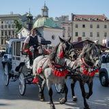 KRAKAU, POLAND/EUROPE - 19. SEPTEMBER: Wagen und Pferde in Kr Lizenzfreie Stockfotos