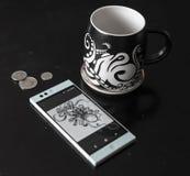 Coffe mug and phone stock photography