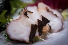 Krakensashimi am japanischen Restaurant Stockfotografie