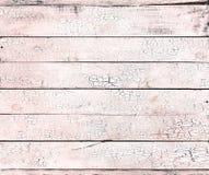 Krakingowa farba na lekkiego żywego koralowego starego drewnianego tła podławej teksturze zdjęcia stock
