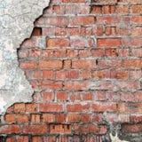 Krakingowy betonowy ściana z cegieł. Obrazy Stock