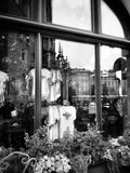 Krakow, architecture, reflections in shop windows. Artistic look in black and white. The historic city. Grodzka and Florian streets in the old city Royalty Free Stock Photos