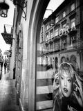 Krakow, architecture, reflections in shop windows. Artistic look in black and white. Stock Images