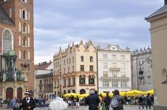Krakow Augusti 19,2014: CentrumPlaza i Krakow, Polen Fotografering för Bildbyråer